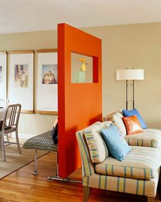 don't want to commit to painting a whole wall a bold color? how about a room divider.  Keep the walls a neutral.