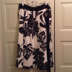 NWT White House Black Market skirt NWT White House Black Market skirt. Black and white floral with side zipper and side black tie White House Black Market Skirts