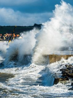 huge wave south wales | Britain battered by bad weather with flood warnings for 20 rivers ...