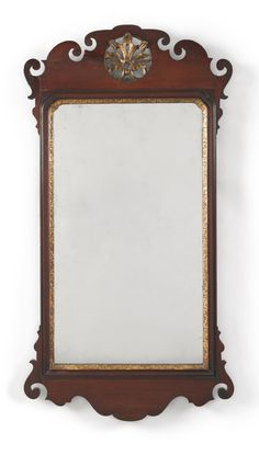 RARE CHIPPENDALE PARCEL-GILT AND FIGURED MAHOGANY LOOKING GLASS, LABELED JOHN ELLIOTT, PHILADELPHIA, CIRCA 1770 - With paper label on back. Height 38 3/4 in. by Width 20 1/2 in.