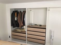 IKEA hack - built-in wall of wardrobes...they even put plaster around it to create a seamless look.