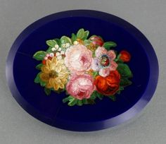 Victorian micro mosaic flower brooch c 1880's. The brooch has a dark blue background with good quality micro mosaic inlay. The brooch measures 46.5mm by 37mm or 1 7/8'' by 1 1/2''.