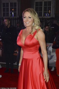 Pride of Britain Awards: Host Carol Vorderman, slips her curves into a plunging red gown as she makes rare red carpet appearance with son Cameron, and daughter Katie, 28 Red Gowns, Satin Dresses, Sexy Older Women, Sexy Women, Beautiful Women Over 50, Pride Of Britain, Carol Vorderman, Holly Willoughby, Voluptuous Women