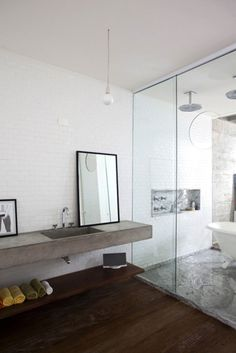 Second bathroom I have seen with double shower heads and an enclosed tub together.