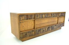 A Beautiful Brutalist Credenza in the style of Paul Evans    By Lane    Circa 1970s      A Beautifuly designed Brutalist Credenza by Lane in
