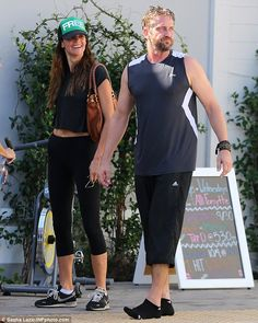 Workout time: Gerard Butler and girlfriend Morgan Brown hit the gym together on Saturday i...