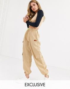 Ellesse high waist cargo pants with pockets at ASOS. Shop this season's must haves with multiple delivery and return options (Ts&Cs apply). Ellesse, Asos, Trousers Women, Pants For Women, Cargo Pants Outfit, Pantalon Cargo, Culotte Pants, Look Casual, Nike Tech Fleece
