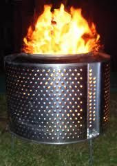 Washing machine drum fire pit-my dad has one of these!! It's awesome! Perfect fire pit. We've even cooked on it!