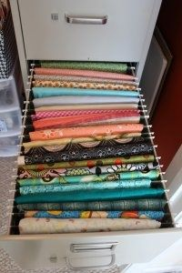 Organize your fabric in an old filing cabinet.