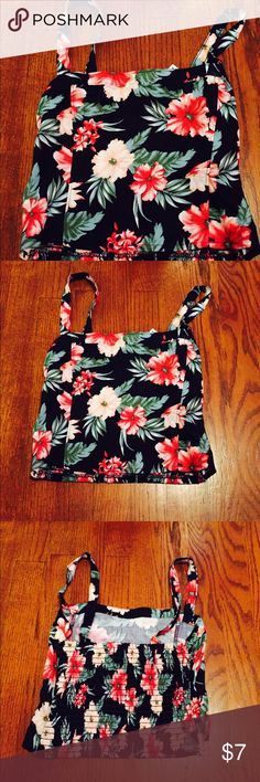 Floral printed crop tank Vibrant floral print crop top by hollister, vibrant hues of red, pink and green set against a black drop, very stylish. Pairs cute with shorts, jeans, skirts or even useful as a cute layering piece. NWT. Hollister Tops Crop Tops