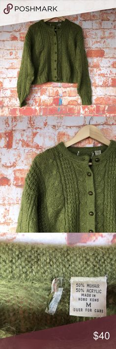 Green mohair-blend sweater with buttons Stunning green knitted sweater with seven brass buttons up the front. The brand tag has been removed :( but this sweater is unique and well-made! Tagging as anthro for views only. Anthropologie Sweaters Cardigans