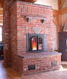 Brick masonry heater made with reclaimed brick, sand and lime mortar, lilac bluestone and a Heat-Kit heater core. By William Davenport. turtlerockheat.com. To reduce stress, masonry heaters in North America are usually built with a double-wall system; a refractory core including firebox and channels or baffles, and a separate, unattached masonry veneer. Otherwise the heat of the firebrick might crack the façade, although brick is least likely to be stressed.