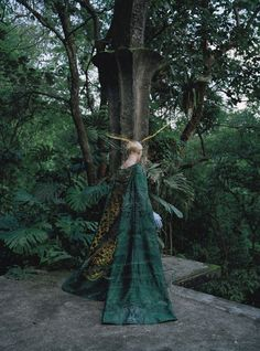Mary Katrantzou dress; Cornelia James gloves. Photographs by Tim Walker Styled by Jacob K May 2013