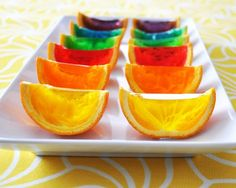rainbow jello orange slices Cut Orange in half Remove fruit from peel put halves in muffin pan make jeelo according to box fill halves with jello of choice cover with wax paper (optional) refridgerate for 4 hours Slice in to 3 or four wedges Voila! Jello Orange Slices, Orange Jello, Rainbow Jello, Rainbow Snacks, Rainbow Shots, Rainbow Food, Orange Wedges, Good Food, Appetizers