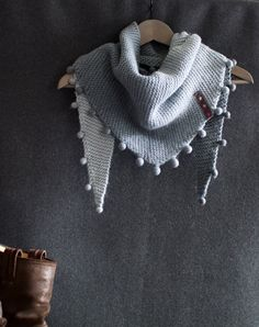 50% merino wool 25% alpaca 25 % silk  78 inches wide h = 15 inches  hand dyed from grey to light grey  37 hand felted beads decor