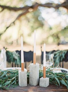 Nothing says simple and chic wedding decor like these cement candleholders surrounded by lush eucalyptus.