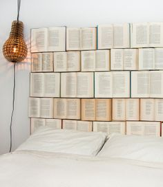 DIY Book headboard!!!  I would only use the books I hate... like math books!