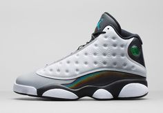 This Air Jordan 13 Retro comes in an all new white, black, tropical teal and wolf grey colorway. Description from polyvore.com. I searched for this on bing.com/images