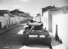 """German tank """"Tiger"""" undermined and abandoned by the Germans on the streets of the Sicilian city of Biscari."""