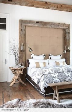 Interesting idea, I might execute with different fabric on the headboard, but I like the beam framed in idea!