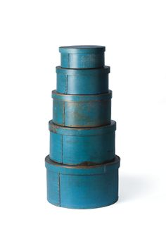 NEST OF FIVE NEW ENGLAND CIRCULAR PANTRY BOXES IN BLUE PAINT.  Sold: $ 2,124.00   Diameters 6 1/4 to 10 1/2 inches.