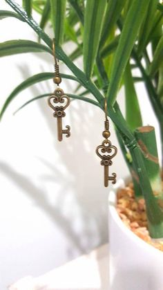 Check out this item in my Etsy shop https://www.etsy.com/au/listing/546918085/antique-gold-key-earrings