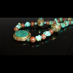 Unique Tibetan Turquoise necklace. One of a kind. You will stand out in a crowd with this baby. It is made out of real turquoise stones. I cannot confirm if the metal around the stones is gold or not...I don't want to mislead you. However, when you hold the necklace in your hand it feels substantial and not hollow plastic. You'll love it! One of a kind Jewelry Necklaces