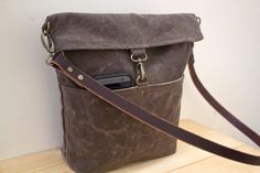 For fashion and durability, have a look at our #WaxedCanvas Day Bag. #DoryDesigns https://www.etsy.com/listing/248778742/waxed-canvas-day-bag-cross-body-bag?ref=shop_home_active_11