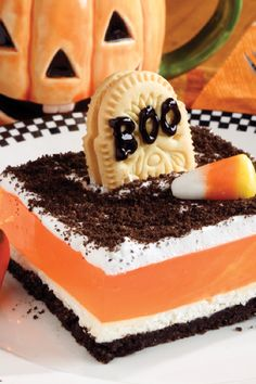 graveyard gelatin dessert its topped with cookie tombstones but the scary costume can