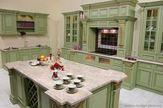 """#Kitchen Idea of the Day: Green cabinets garnished with gold: Gorgeous, or Gross?! We call it, uhm, """"Unique!"""" Unique Kitchens."""