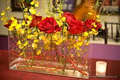 bright yellow oncidium orchids with red roses was a bold and fabulous choice for this reception!
