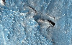 "July 1, 2015 The High Resolution Imaging Science Experiment (HiRISE) camera aboard NASA's Mars Reconnaissance Orbiter acquired this closeup image of a light-toned deposit in Aureum Chaos, a 368 kilometer (229 mile) wide area in the eastern part of Valles Marineris, on Jan. 15, 2015, at 2:51 p.m. local Mars time. The objective of this observation is to examine a light-toned deposit in a region of what is called ""chaotic terrain."" There are indications of layers in the image. Some shapes…"