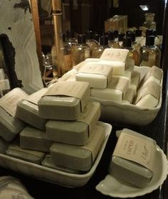 soaps in white bowls and platters - beautiful!