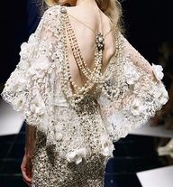 Lace on one's back makes for a beautiful exit.