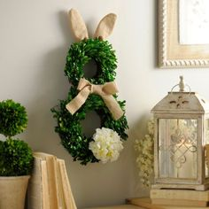 Boxwood Easter Bunny Wreath | Kirklands Item#136986 $39.99. Hop right into spring style with our Boxwood Easter Bunny Wreath. Its adorable bunny shape, paired with its burlap accents, are sure to bring joy to your Easter festivities.  Wreath measures 12L x 2W x 25H in. Features a stable base of woven branches Crafted of artificial materials Green boxwood finish with silk hydrangea tail Bunny design with burlap ears and bow Care: Recommended for indoor or covered outdoor use.