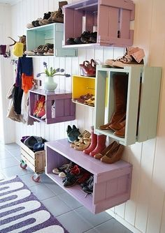 Wooden crates used as storage. Perfect way to store shoes and other essentials in a foyer! #style #design #home #interiors