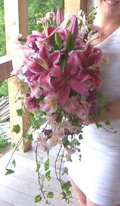 A wedding bouquet using stargazer lilies, ivy, etc. created by Linda Ragland and Ruth West
