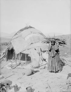 Apache woman hauling firewood on her back