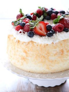 Light as air angel food cake scented with coconut and topped with fresh berries. It's a perfect summer dessert! : Light as air angel food cake scented with coconut and topped with fresh berries. It's a perfect summer dessert! Köstliche Desserts, Summer Desserts, Delicious Desserts, Angel Food Cake Desserts, Health Desserts, Angel Cake, Baking Recipes, Cake Recipes, Dessert Recipes