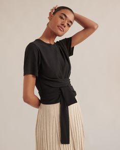 The Jude Short-Sleeve Wrap Blouse is a flattering blouse with wrap detailing creates an elegant silhouette — dressing up beautifully with trousers and heels, or casually with a breezy skirt or denim and slides. Crop Blouse, Black Blouse, Editorial Fashion, Fashion Trends, Dress Silhouette, Haute Couture Fashion, Citizen, Dress Up, Elegant