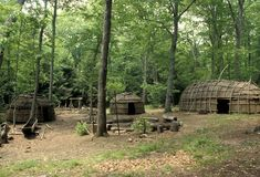 Iroquois Village : Iroquois village including a bark longhouse, wigwams and a dug out canoe typical of the Six Nation tribes of the Northeast United States and parts of Canada. (Photo Credit: Marilyn Angel Wynn/Nativestock Pictures/Corbis)