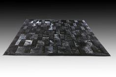 Design: Baltik,  Size: 220x300cm,  Material: Black dyed cowhide & lambskin
