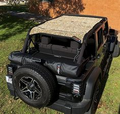 "JTopsUSA - Jeep Wrangler ""Safari"" summer mesh shade top Exclusive to JTopsUSA Is this Mossy Oak® ""Blades"" pattern, Shown on 4 Door JK with black Tonneau and Soft Top Storage Boot. Jeep Jku, Boot Storage, Jeep Wrangler Accessories, Summer Shades, Custom Jeep, Tonneau Cover, 4x4, Safari, Vehicles"