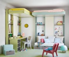 Cute, simple, modern kids' room with pastel colour blye and green, loft beds and reading and work spaces. By Espace Loggia