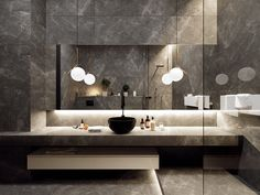 STORMY GRAY   If Batman designed a bathroom, it might look something like this. This high-end vanity gives you plenty of counter space and light where you need it.