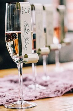Champagne escort cards | Photo by VUE Photography