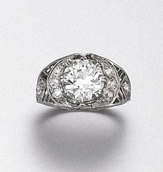 DIAMOND RING, CIRCA 1920. Centering an old European-cut diamond weighing approximately 2.45 carats, within a pierced band decorated with small old-mine diamonds, mounted in platinum Diamond Jewellery, Gems Jewelry, Jewelery, Fine Jewelry, Vintage Costume Jewelry, Vintage Jewelry, Beautiful Diamond Rings, Trophy Wife, Rare Gems