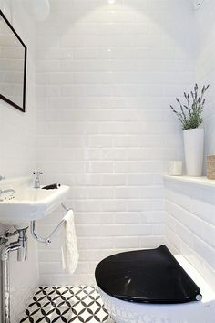 Small bathroom. Loving those subway tiles!
