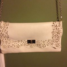 White purse with long silver chain. Super cute, gently used. There is some wear, but very minimal and not noticeable. No scratches or tears. I've put the chain in the purse and carried it as a clutch. Bags Shoulder Bags