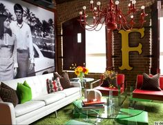 Awesome eclectic mix... modern + vintage + exposed brick wall + painted chandelier